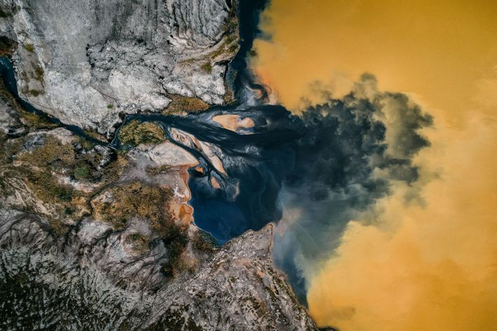 Minerals color a wastewater pond after mining.