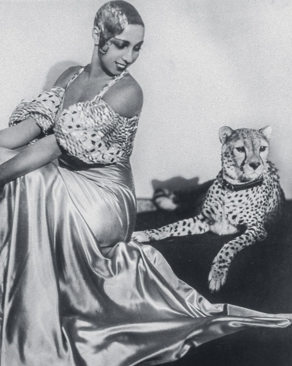 Cabaret star Josephine Baker poses with her cheetah, Chiquita, in the 1930s. A gift from a ...