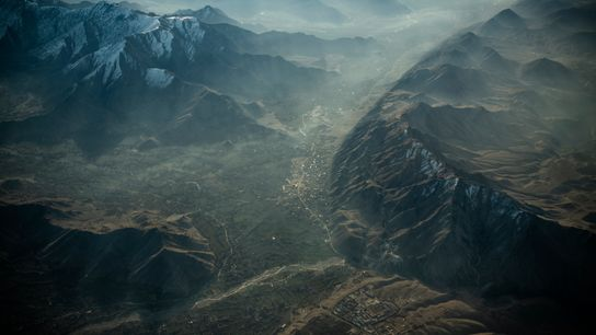 Landlocked and mountainous, Afghanistan borders six countries and is dominated by the imposing Hindu Kush range, ...