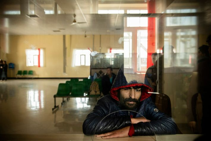 Ali, 30, registers at the Afghan border on November 18, 2019. He had been living in ...
