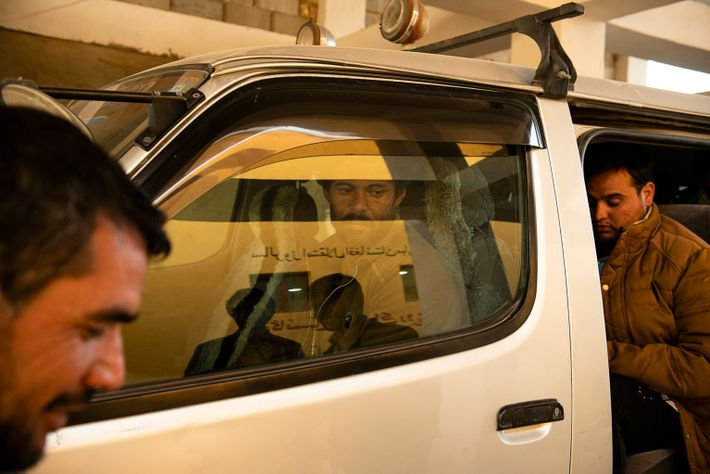 Mohammad Barat, 34, is transported to the transit center in the southwest border city of Zaranj. ...