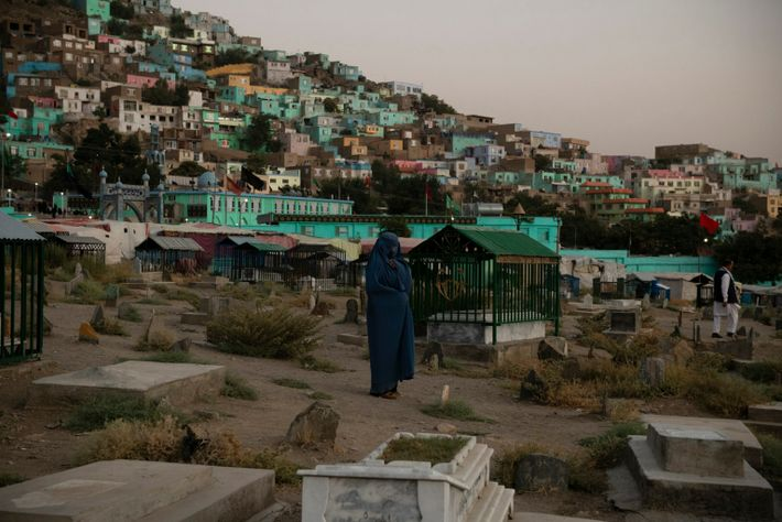 A woman mourns at Karte Sakhi cemetery in western Kabul on a Thursday evening in September ...