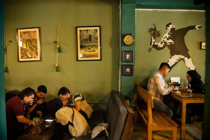 Young Afghans hang out at Simple Cafe, located in the Pul-e Surkh neighborhood of Kabul, in ...