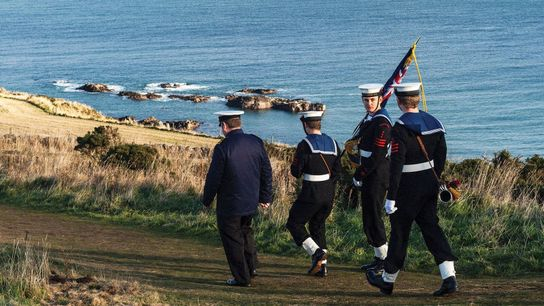 Sea cadets descending the hill from the Stonehaven War Memorial after a ceremony. Stonehaven has a ...