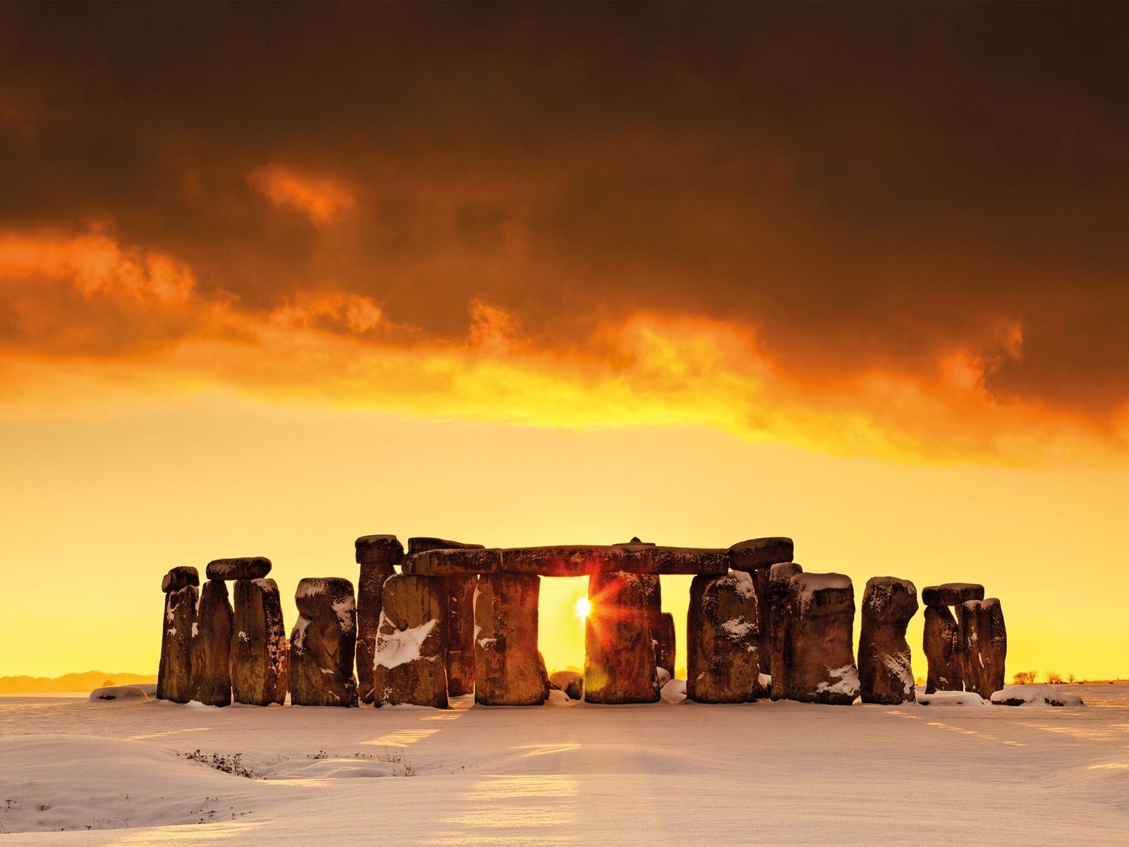 Snow cloaks the Salisbury Plain in England, dominated by its most celebrated monument. Built 4,500 years ...
