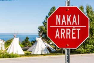 Stop signs are in French and Innu-Aimum (an Algonquin language) in Les Escoumins, an Innu Essipit ...