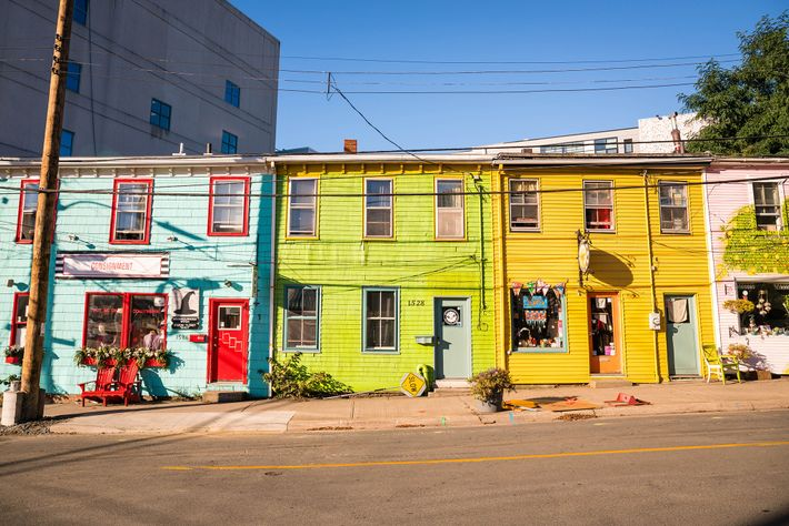 A row of brightly painted shops lends character to Queen Street in downtown Halifax.