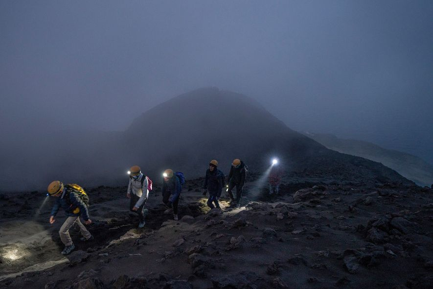 Mario Zaia, one of the island's most experienced guides, leads a group of hikers up Stromboli ...