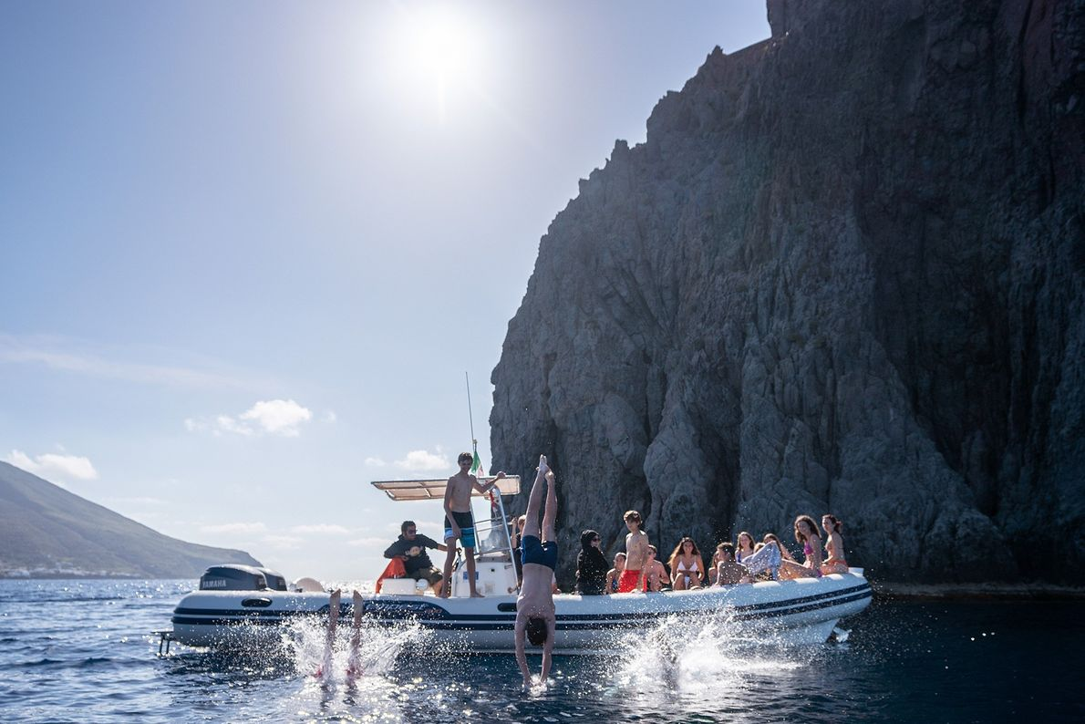 Local boat outfitters circle Stromboli, giving visitors 360-degree views of the volcanic island.