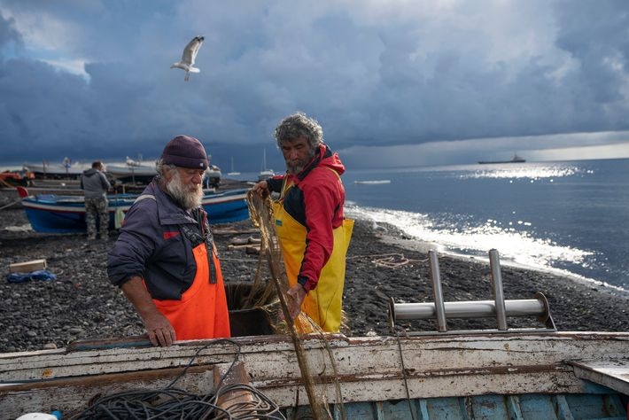 Fishermen return to shore after spending the night out at sea.