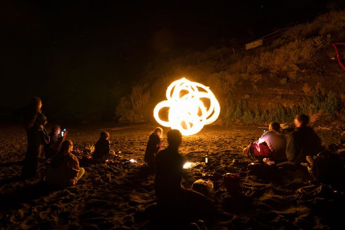 Fire artists from around the world gather on the island and perform together.