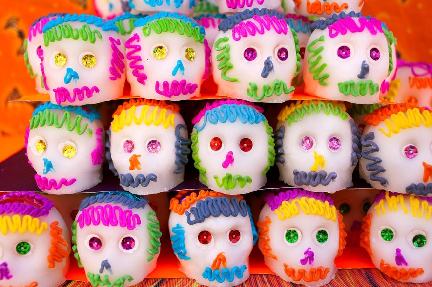 Sugar skulls are sold in many forms across Mexico. This colorful group has sequins for eyes ...