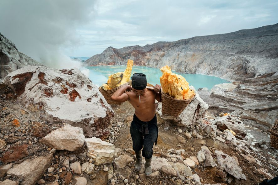 Sunarto, 41 years old, carries a load of sulphur out of the Kawah Ijen crater.