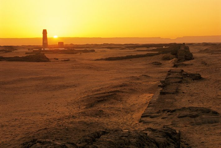 The sun rises over the ruins of the Great Aten Temple in present-day Amarna, Egypt. Akhenaten ...