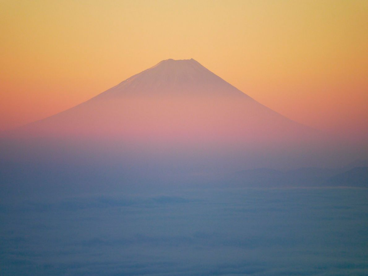 A sea of clouds covers Lake Suwa as the morning sun reveals a painterly scene of ...