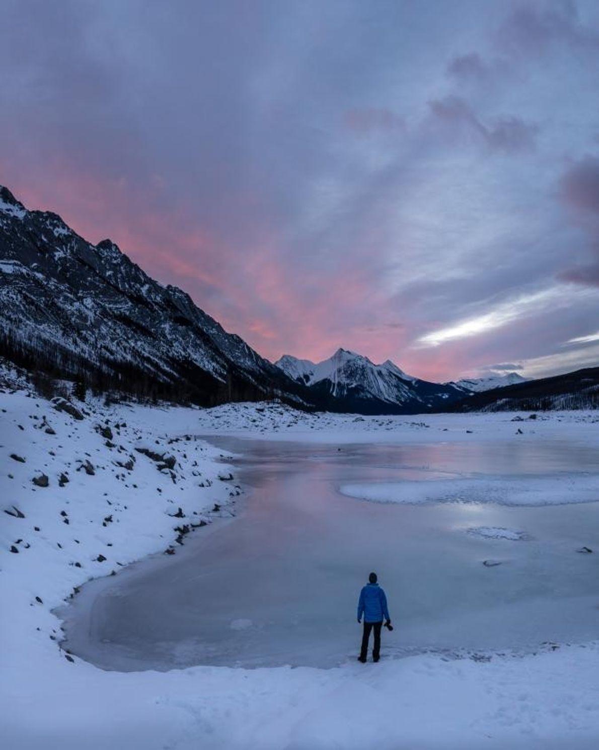 Watching sunrise above Medicine Lake, 16 miles from Jasper, on the Maligne Lake Road in Jasper ...