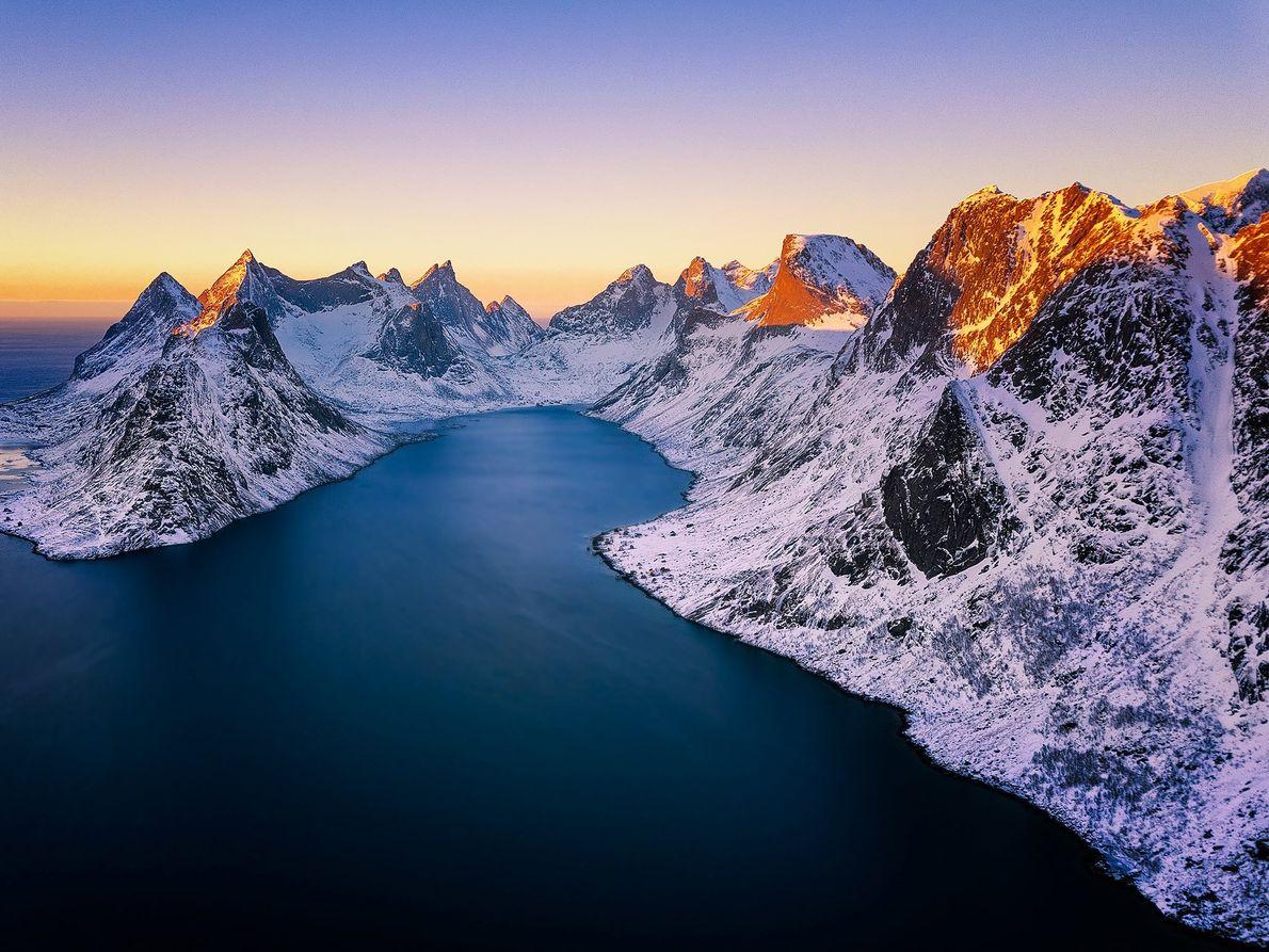 """Aerial shot of sunset over Reine, Lofoten Islands, Norway."""