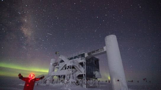 Sven Lidström takes a selfie in front of the IceCube Neutrino Observatory during an Antarctic winter.