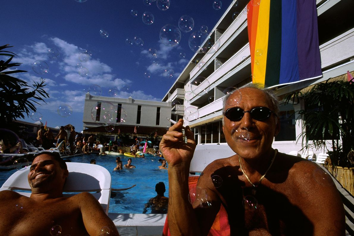 Vacationers share a laugh at the Paradise Club in Asbury Park, New Jersey. Located along the ...