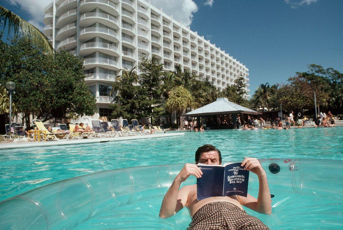 Tourists enjoy the pool at Atlantis Paradise Island, a resort in the Bahamas.