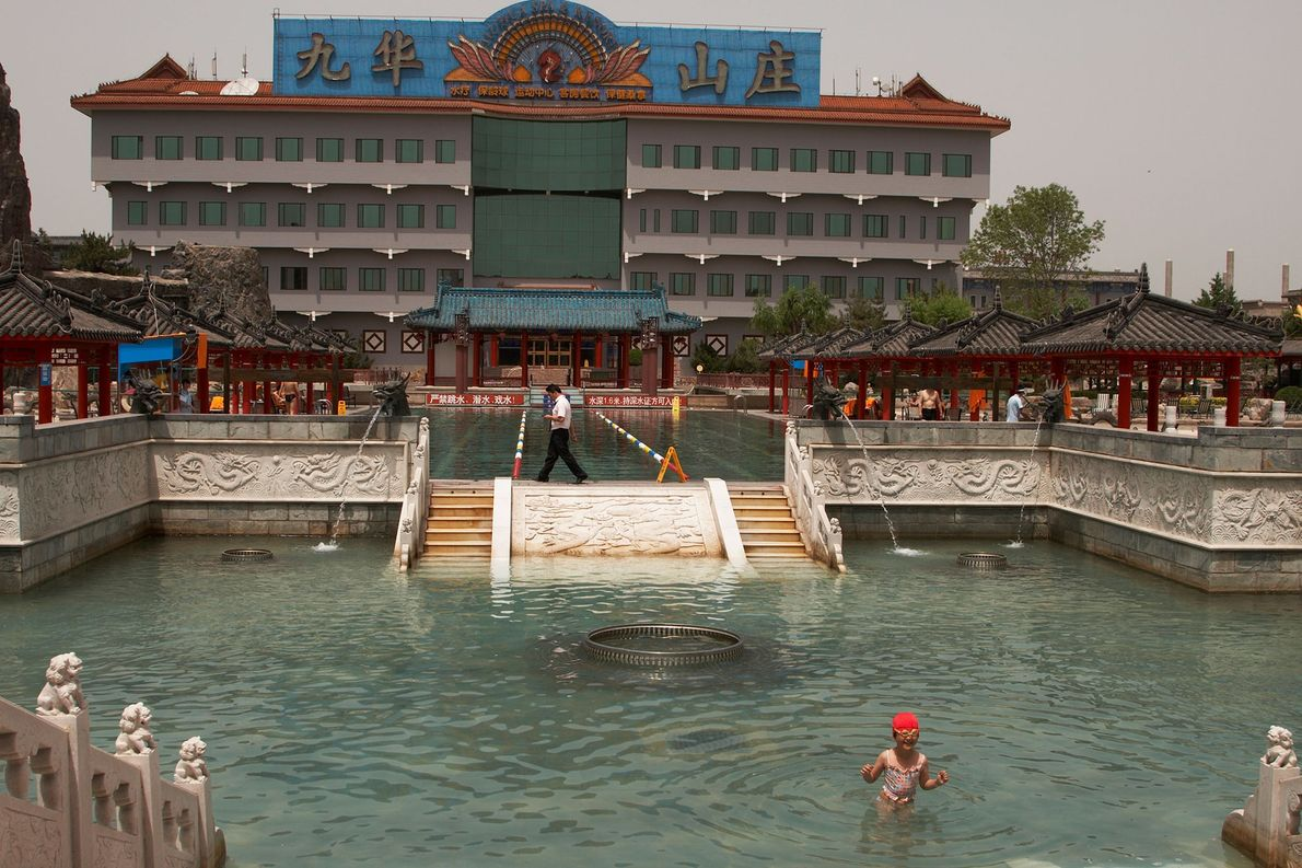 A person swims in an elaborate pool at a spa in northern Beijing, China.