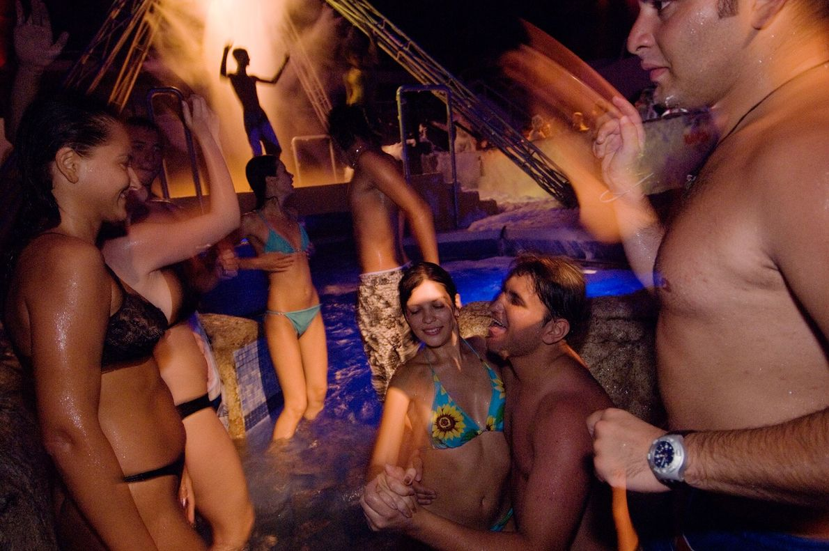 Revellers dance the night away in a pool at Pacha, an internationally renowned dance club in ...