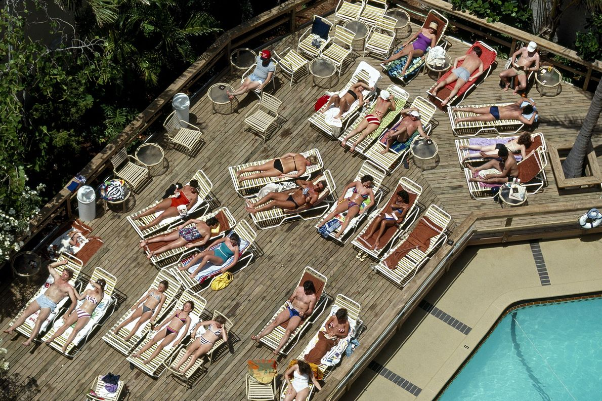 Swimmers sun themselves by a pool in Florida.