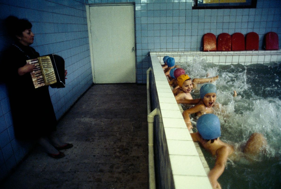 Children kick along in a pool to traditional music at a daycare in Kiev, Ukraine.