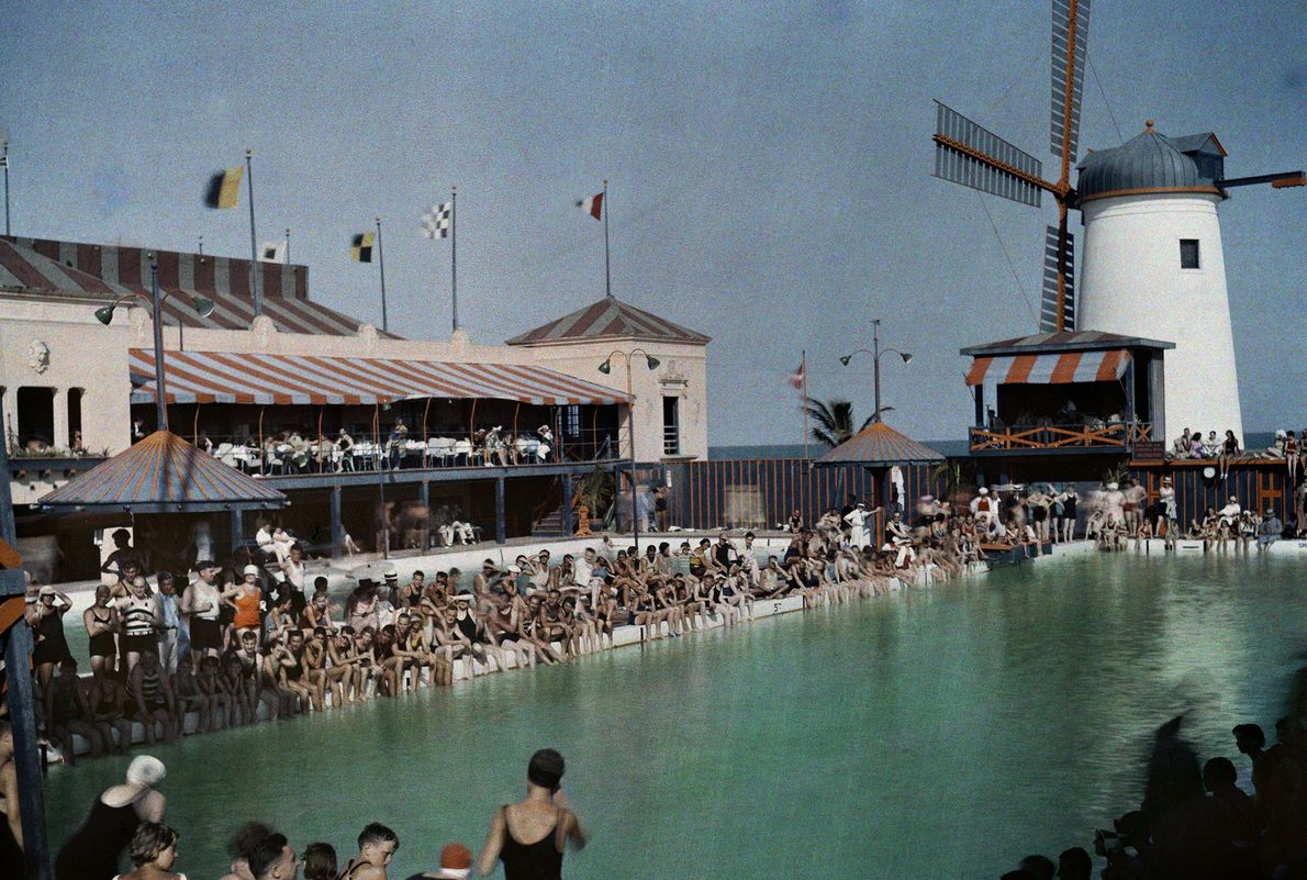 Crowds form at a pool for a swim competition in Miami Beach, Florida.