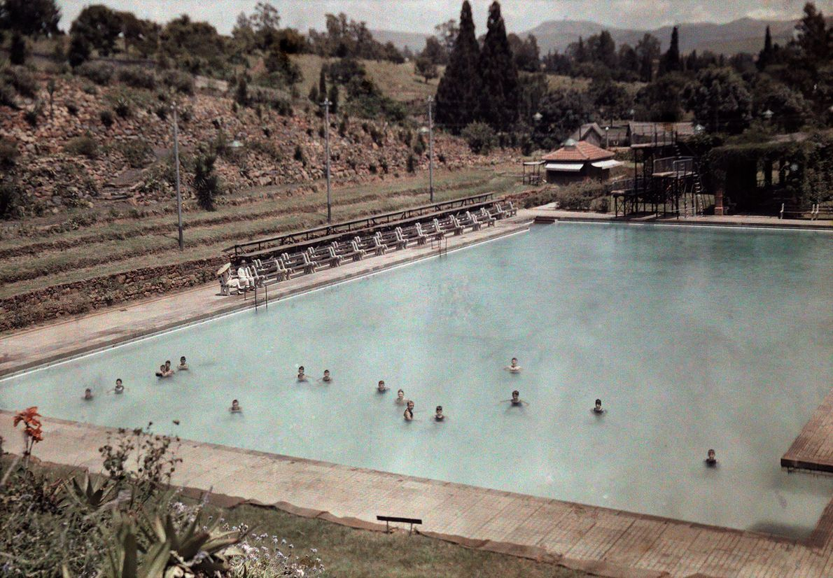 South African locals swim in an outdoor pool in the middle of January—a warm summer month ...