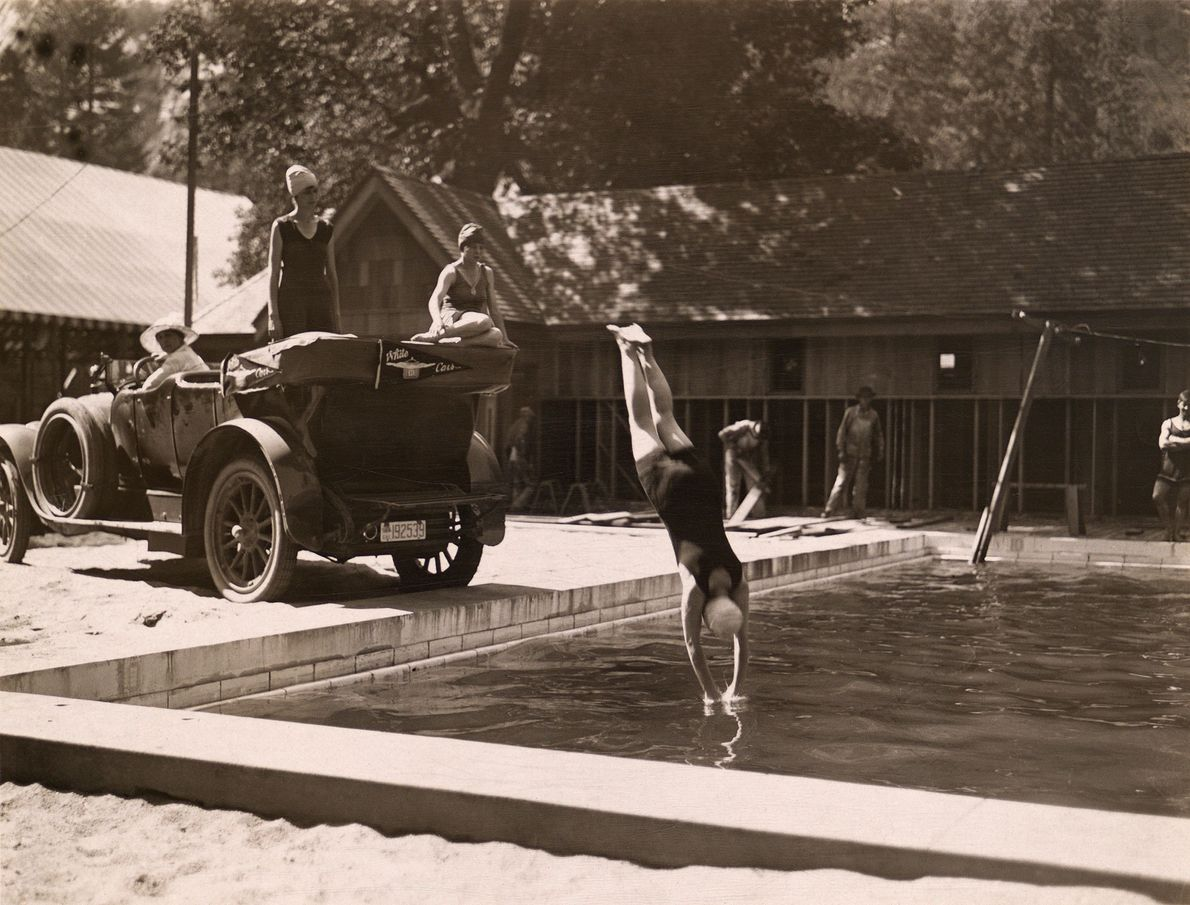 A woman dives into a pool at Yosemite National Park, California, in the early 1900s.