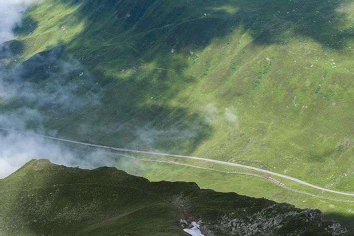 The epic natural surroundings dwarfing the Glacier Express as it makes its way along the Oberalp ...