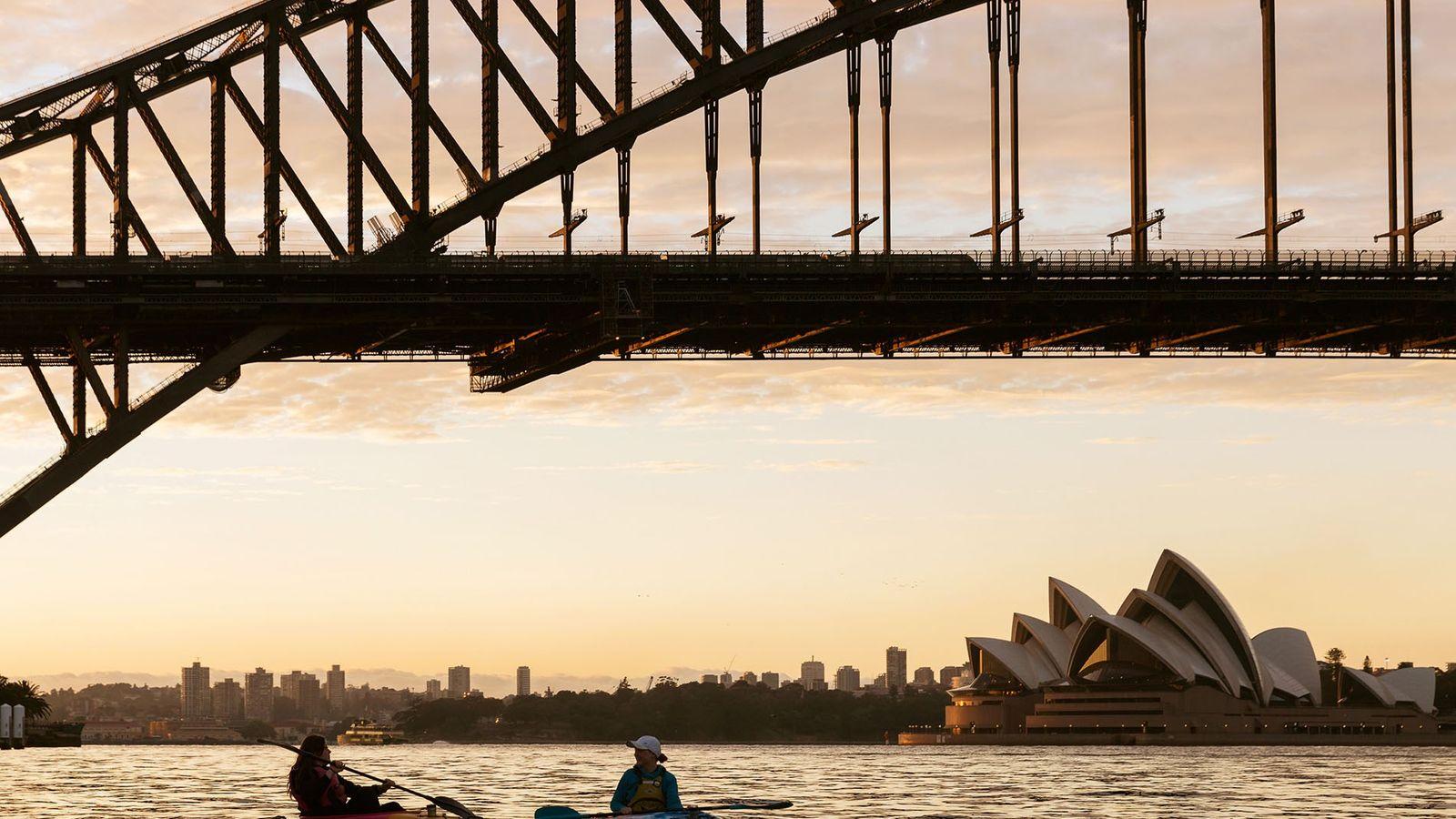Kayaking beneath the Sydney Harbour Bridge at dawn