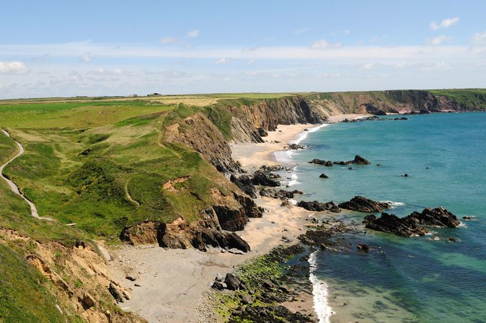 Marloes Sands is a mile-long sandy beach surrounded by cliffs.