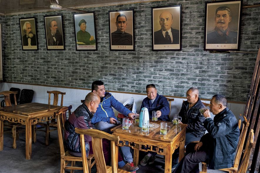 Underneath portraits of Communist leaders, friends gather at a teahouse in Luocheng, an ancient Sichuan town ...