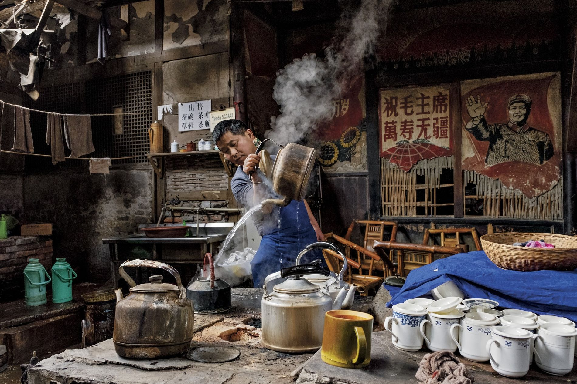 In Sichuan Province, pouring hot water for tea or refilling a teapot from high above is ...