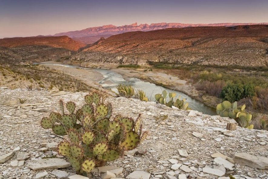 Rio Grande flowing through the Chihuahuan Desert, with the Sierra del Carmen on the horizon.