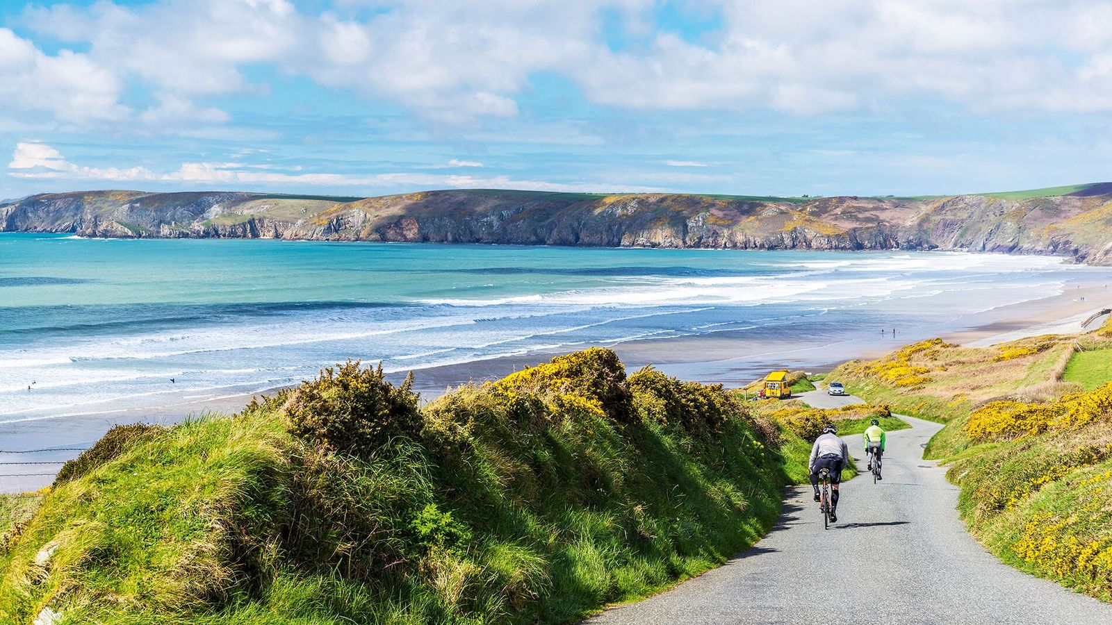 Cyclists make their way through Pembrokeshire Coast National Park in West Wales.Sustainable travel is complicated and, ...