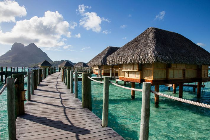 Places like the Society Islands of Bora Bora, French Polynesia are under threat from environmental pressures ...