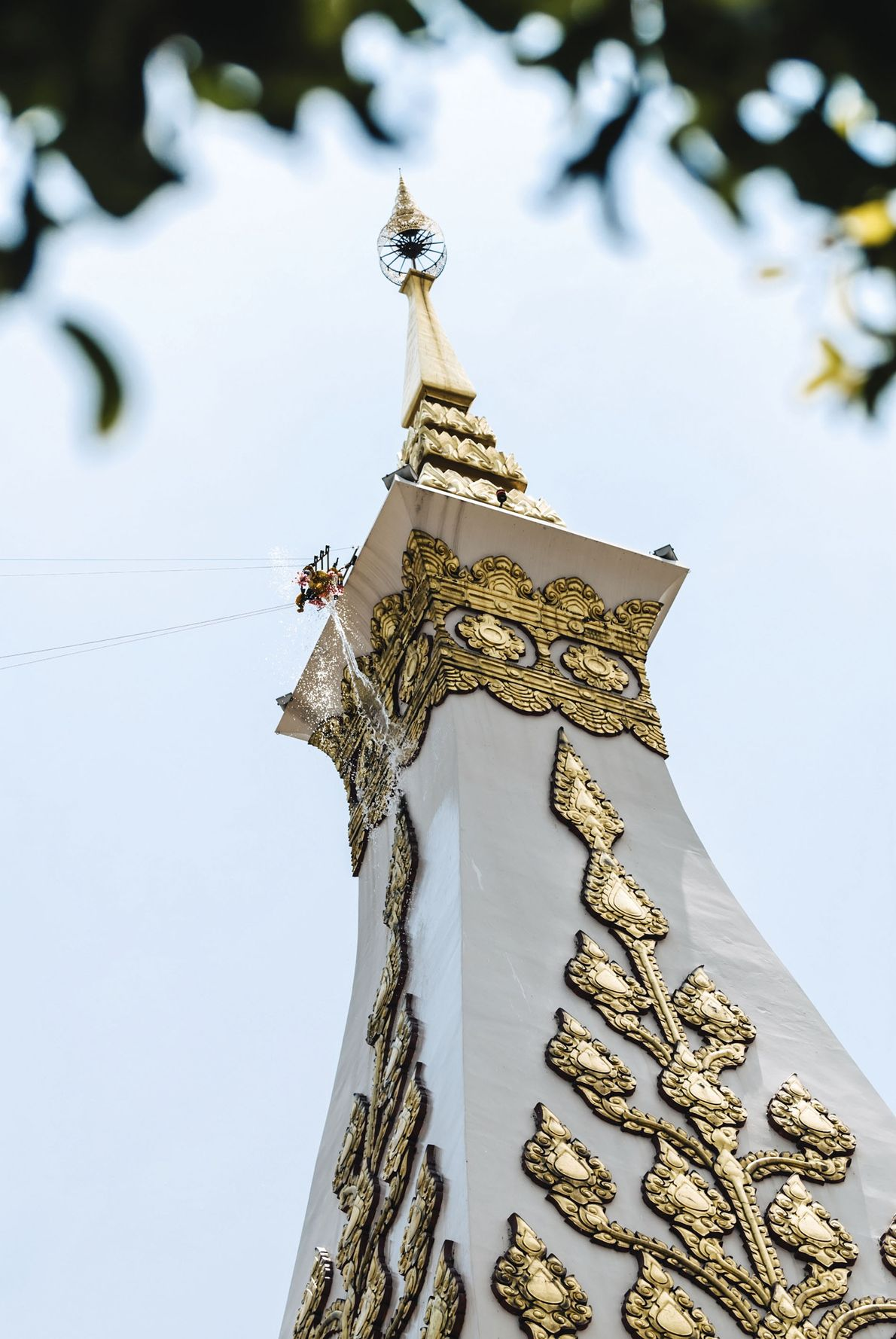 During the three days of Songkran, Wat Phra That Phanom is outfitted with an elaborate rig ...