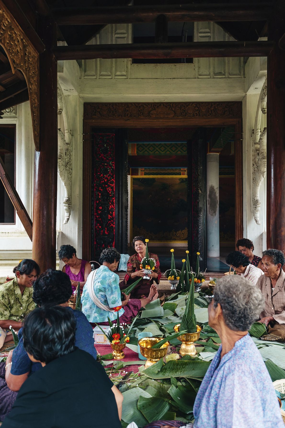 On religious days, villagers gather at the local temple where teams of celebrants clean, cook communal ...