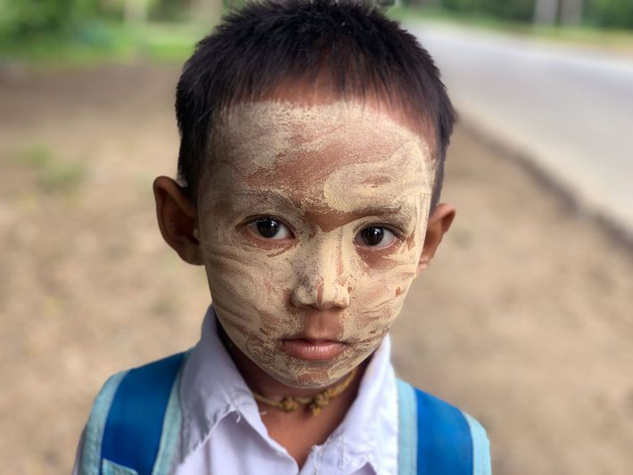 Ar Kar Phyo, 6, wears a liberal smearing of thanaka to his primary school near Ye ...