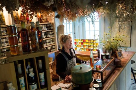 Beverly McClare greets guests to the shop where she sells herb-infused jellies and liqueurs at her ...