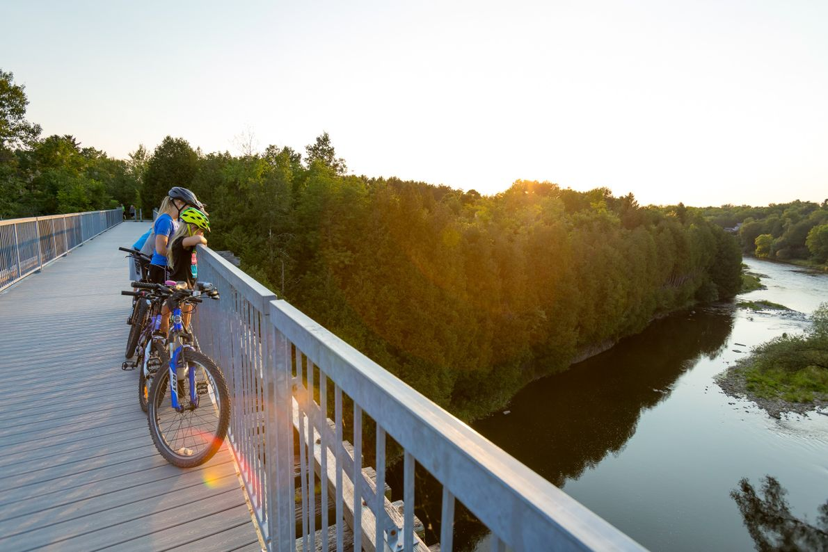 The Trestle Bridge spans the Grand River and is part of the trail that connects the ...