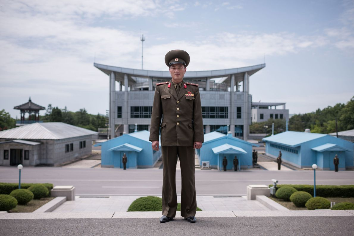 Korean People's Army (KPA) soldier Lieutenant Kim poses for a portrait on the north side of ...