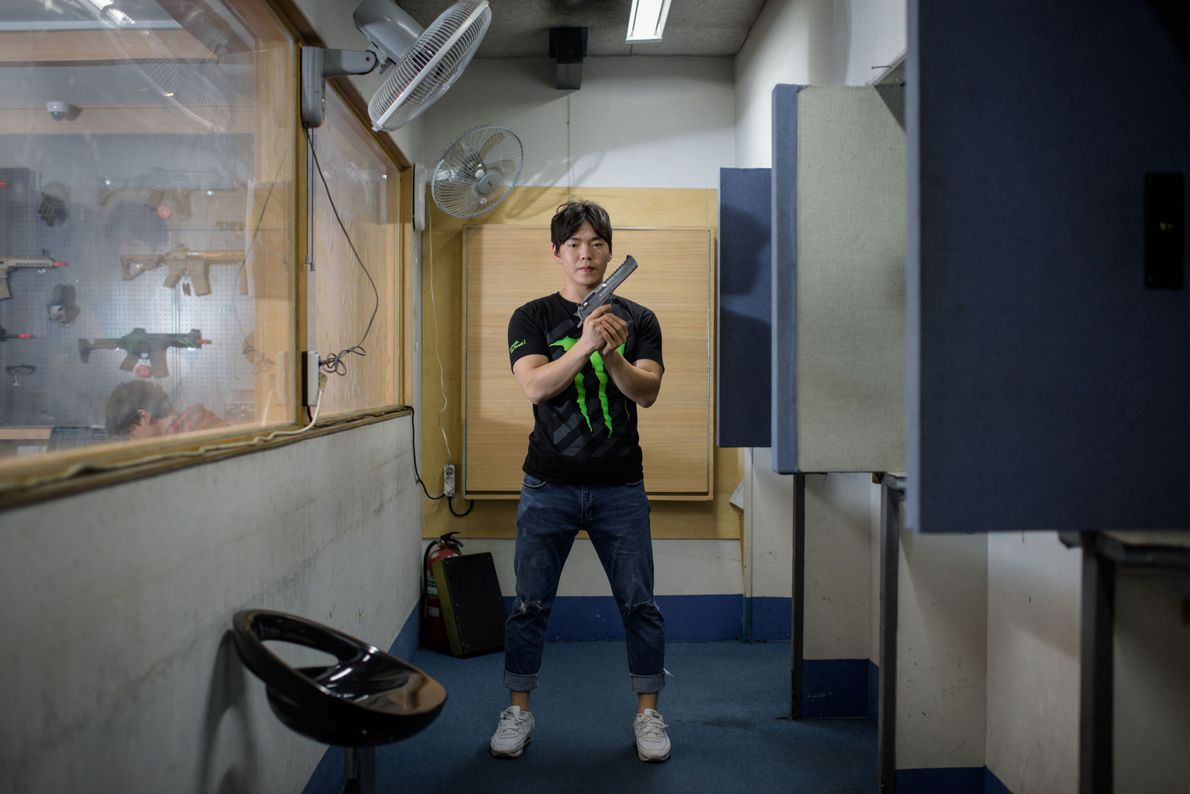 South Korean shooting instructor Lee Chi-yoon holds a gun and poses for a portrait at the ...