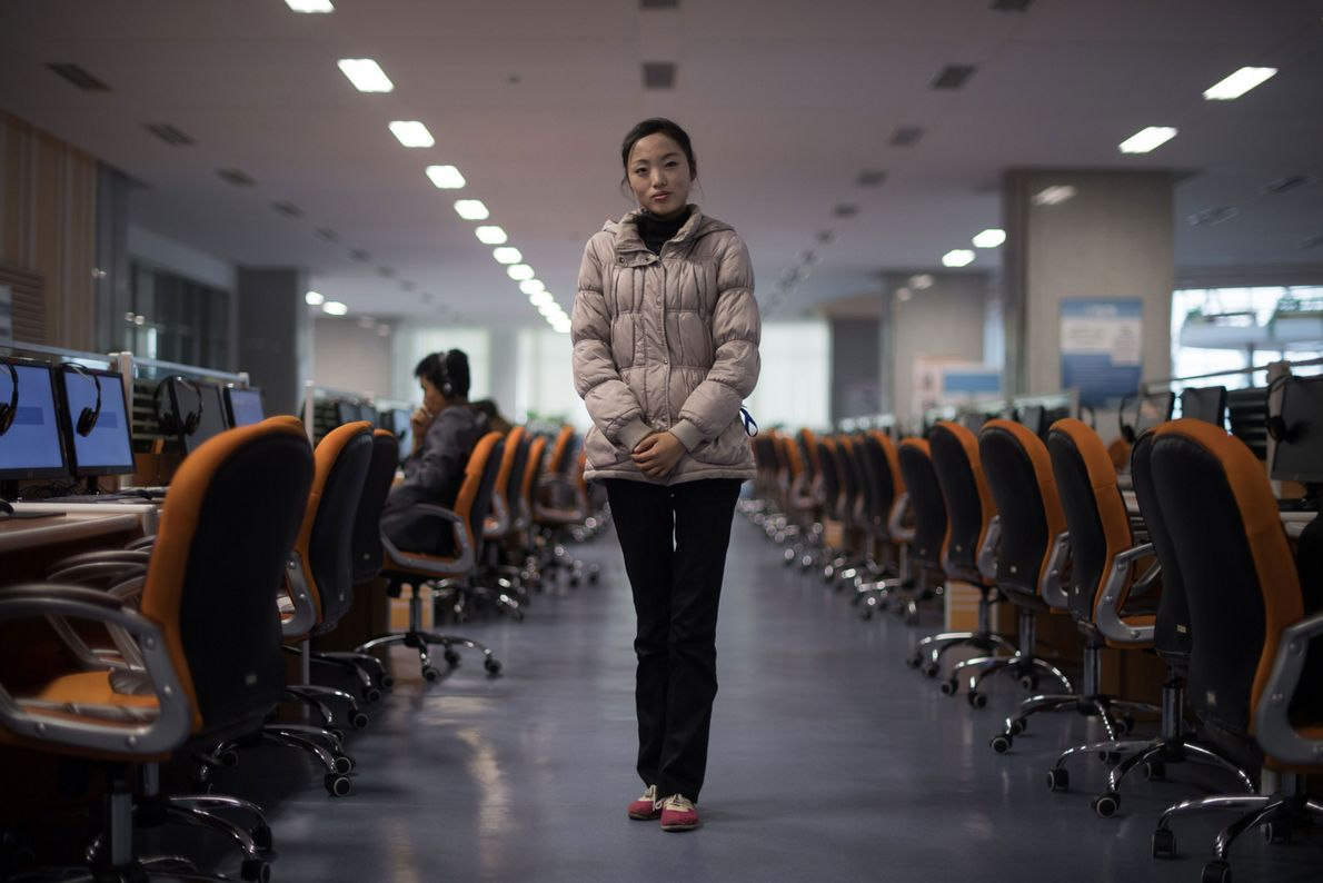 Volunteer staff member and student Ri Young Hwa, 19, stands in a computer lab at the ...