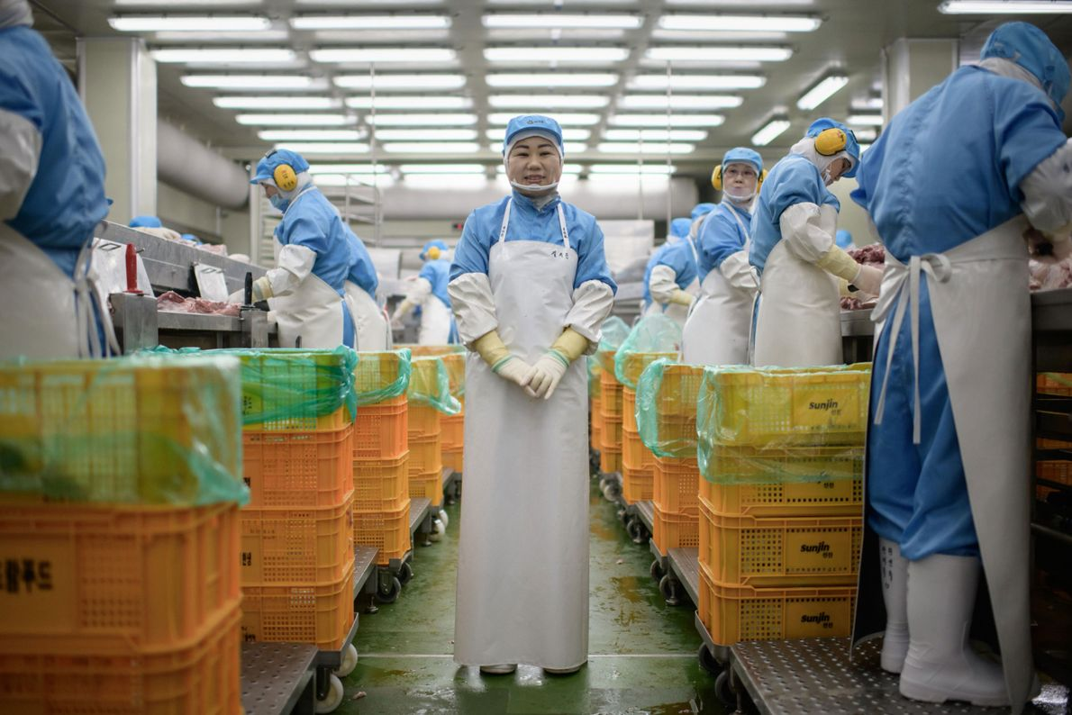 Kim Si-eun, 49, stands in the Spam factory where she works in Jincheon, south of Seoul, ...