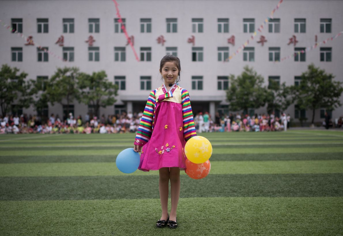 Kim Song Jong, nine, poses for a portrait following a dance performance at a Children's Day ...