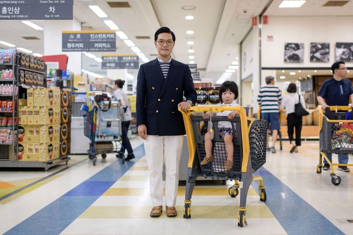 Hong Sung-cho, 35, stands with his son Hong Jinu, two, at a supermarket in Bundang near ...